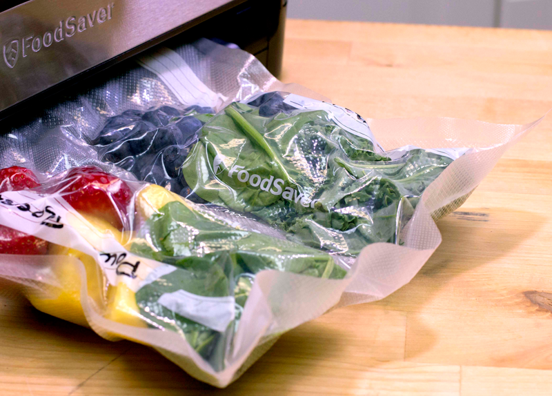 saving fruit and veggies inside a vacuum food sealer - Vacuum Food Sealer